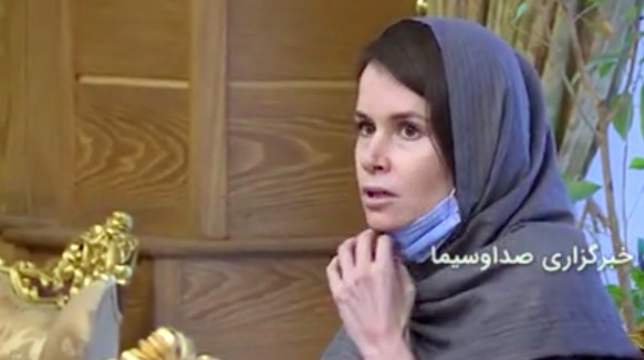 epa08841626 A handout video grab taken from a video from Iran state TV (IRIB) shows, dual British -Australian citizen Kylie Moore-Gilbert  during a prisoner swap at the Mehr-Abad airport in Tehran, Iran, 25 November 2020. Media reported that Moor-Gilbert has been released in exchange with three Iranian prisoners abroad, as she was sentenced to 10 years jail in Iran.  EPA/IRIB HANDOUT BEST QUALITY AVAILABLE HANDOUT EDITORIAL USE ONLY/NO SALES
