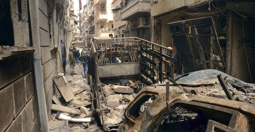 In this photo released by the Syrian official news agency SANA, Syrians gather in a street that was hit by shelling, in the predominantly Christian and Armenian neighborhood of Suleimaniyeh, Aleppo, Syria, April 11, 2015. Russia has proposed a March 1, 2016, ceasefire in Syria, U.S. officials said Feb. 10, but Washington believes Moscow is giving itself and the Syrian government three weeks to try to crush moderate rebel groups. The U.S. has countered with demands for the fighting to stop immediately, the officials said. Peace talks are supposed to resume by Feb. 25. The conflict has killed more than a quarter-million people, created Europe's biggest refugee crisis since World War II and allowed the Islamic State to carve out its own territory across parts of Syria and neighboring Iraq. (AP Photo/SANA)