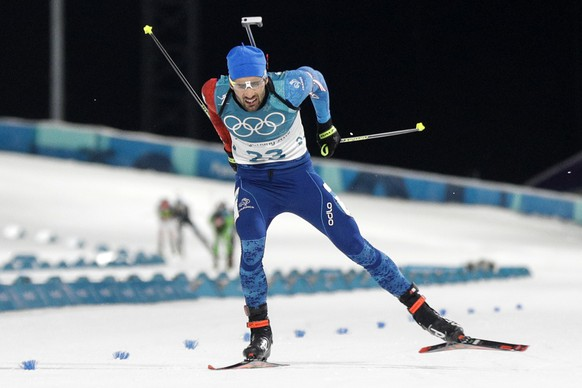 Martin Fourcade, of France, skis across the finish line during the men's 20-kilometer individual biathlon at the 2018 Winter Olympics in Pyeongchang, South Korea, Thursday, Feb. 15, 2018. (AP Photo/Gregorio Borgia)
