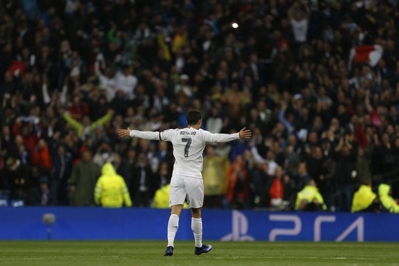 Real Madrid's Cristiano Ronaldo celebrates scoring during the Champions League 2nd leg quarterfinal soccer match between Real Madrid and VfL Wolfsburg at the Santiago Bernabeu stadium in Madrid, Spain, Tuesday April 12, 2016. (AP Photo/Francisco Seco)