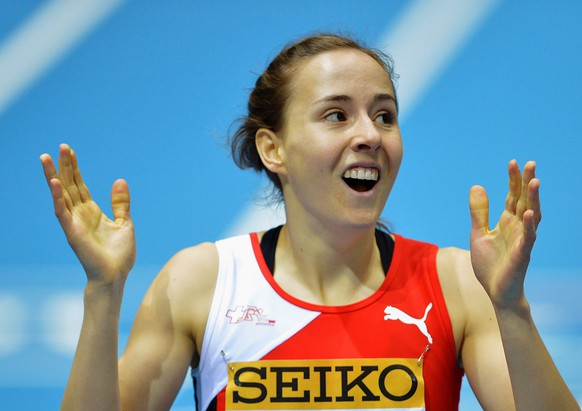 epa04113699 Selina Buechel of Switzerland reacts after competing in the women's 800m heats of the IAAF Athletics World Indoor Championships at Ergo Arena in Sopot, Poland, 07 March 2014.  EPA/ADAM WARZAWA