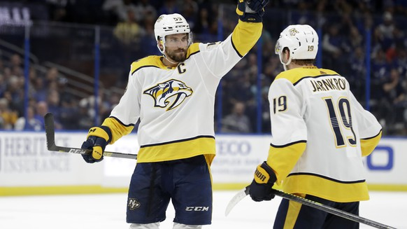 Nashville Predators defenseman Roman Josi (59) celebrates his goal against the Tampa Bay Lightning with center Calle Jarnkrok (19) during the third period of an NHL hockey game Saturday, Oct. 26, 2019, in Tampa, Fla. (AP Photo/Chris O'Meara)Roman Josi,Calle Jarnkrok