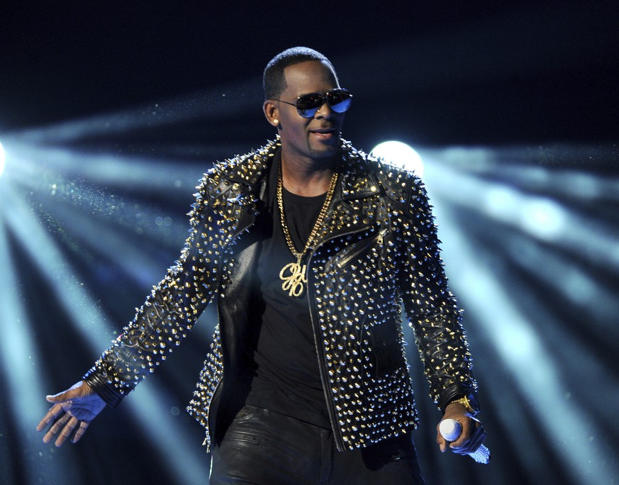 FILE - In this June 30, 2013 file photo, R. Kelly performs at the BET Awards in Los Angeles. A Georgia man involved with a recent documentary detailing abuse allegations against R. Kelly told police the singer's manager threatened him. A Stockbridge police report says Timothy Savage told an officer on Jan. 3 that Don Russell had texted him saying it would be best for him and his family if the documentary didn't air. Savage said he and his wife were involved with Lifetime's