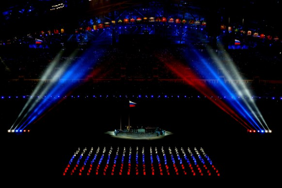 SOCHI, RUSSIA - FEBRUARY 07: Athlete marshals come together to form the Russian flag during the Opening Ceremony of the Sochi 2014 Winter Olympics at Fisht Olympic Stadium on February 7, 2014 in Sochi, Russia.  (Photo by Quinn Rooney/Getty Images)