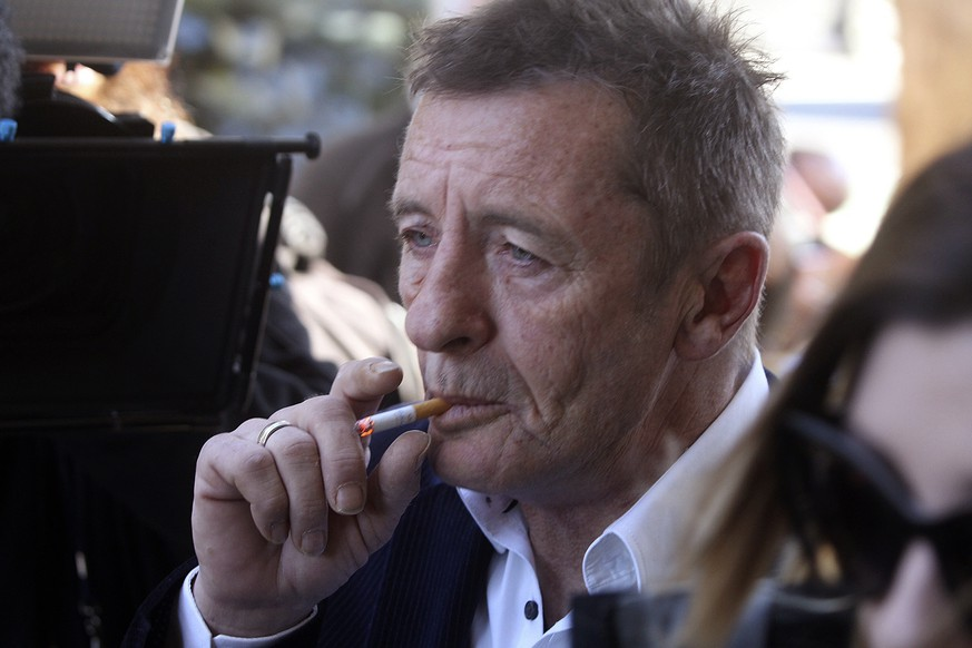 Former AC/DC drummer Phil Rudd arrives for sentencing at the Tauranga District Court in Tauranga, New Zealand, Thursday, July 9, 2015.  A judge sentenced Rudd to eight months of home detention after the musician pleaded guilty to threatening to kill a man who used to work for him, along with possession of methamphetamine and marijuana. (Alan Gibson/New Zealand Herald via AP) NEW ZEALAND OUT, AUSTRALIA OUT