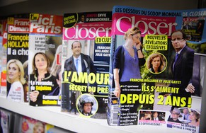 Celebrity news magazines headlining on French President Francois Hollande are on display at a Paris newstand, Friday, Jan. 17, 2014. France's first lady is making progress in a hospital where she is receiving care following a gossip magazine's report that President Francois Hollande was having a secret affair with actress, Julie Gayet, a spokesman said Thursday. Headline at right reads: They are in love for two years. From the left, people on front pages are: Julie Gayet, Segolene Royal, Francois Hollande, Julie Gayet and Hollande. (AP Photo/Zacharie Scheurer)