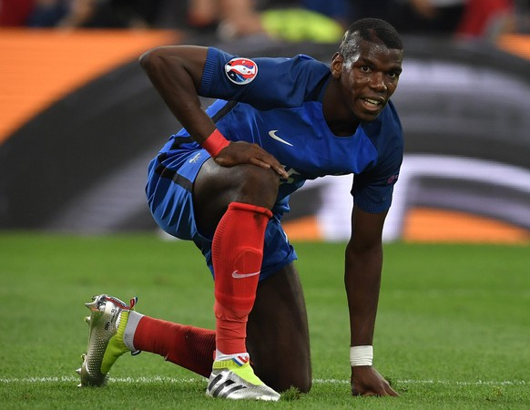 epa05368147 Paul Pogba of France reacts during the UEFA EURO 2016 group A preliminary round match between France and Albania at Stade Velodrome in Marseille, France, 15 June 2016.  (RESTRICTIONS APPLY: For editorial news reporting purposes only. Not used for commercial or marketing purposes without prior written approval of UEFA. Images must appear as still images and must not emulate match action video footage. Photographs published in online publications (whether via the Internet or otherwise) shall have an interval of at least 20 seconds between the posting.)  EPA/PETER POWELL   EDITORIAL USE ONLY