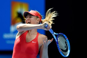 epa04592385 Maria Sharapova of Russia in action against Ekaterina Makarova of Russia during their semifinals match at the Australian Open tennis tournament in Melbourne, Australia, 29 January 2015.  EPA/LUKAS COCH AUSTRALIA AND NEW ZEALAND OUT