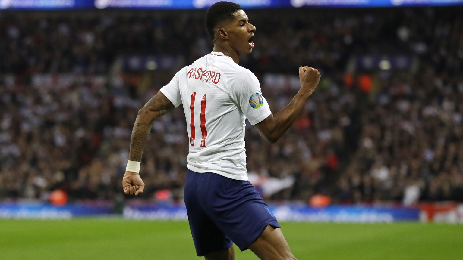 England's Marcus Rashford celebrates scoring his side's fourth goal during the Euro 2020 group A qualifying soccer match between England and Montenegro at Wembley stadium in London, Thursday, Nov. 14, 2019. (AP Photo/Kirsty Wigglesworth)