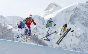 France's Arnaud Bovolenta, Canada's Brady Leman, France's Jean Frederic Chapuis and France's Jonathan Midol (L-R) compete during the men's freestyle skiing skicross finals round at the 2014 Sochi Winter Olympic Games in Rosa Khutor February 20, 2014.           REUTERS/Lucas Jackson (RUSSIA  - Tags: SPORT SKIING OLYMPICS)