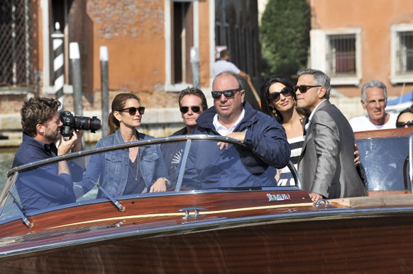 George Clooney, right, his fiancee Amal Alamuddin, Cindy Crawford, second left, and her husband Rande Gerber arrive in Venice, Italy, Friday, Sept. 26, 2014. Clooney, 53, and Alamuddin, 36, are expected to get married this weekend in Venice, one of the world's most romantic settings. (AP Photo/Luigi Costantini)