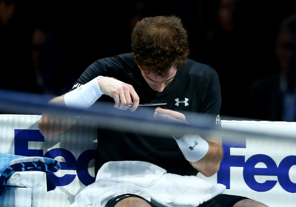 LONDON, ENGLAND - NOVEMBER 18:  Andy Murray of Great Britain cuts his hair in-between games in his men's singles match against Rafael Nadal of Spain during day four of the Barclays ATP World Tour Finals at the O2 Arena on November 18, 2015 in London, England.  (Photo by Clive Brunskill/Getty Images)