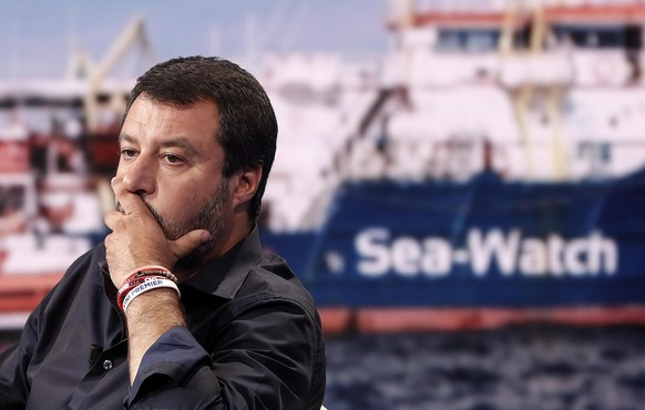 epaselect epa07676507 Italian Deputy Premier and Interior Minister Matteo Salvini attends the Raiuno 'Porta a Porta' (lit. Door-to-door) television talk show, in Rome, Italy, 26 June 2019 (issued 27 June 2019). Salvini commented on the Sea-Watch 3 after the migrant rescue ship, despite the threat of a fine by the Italian government, decided on 26 June to enter Italian territorial waters near the island of Lampedusa with dozens of migrants on board waiting to disembark.  EPA/RICCARDO ANTIMIANI
