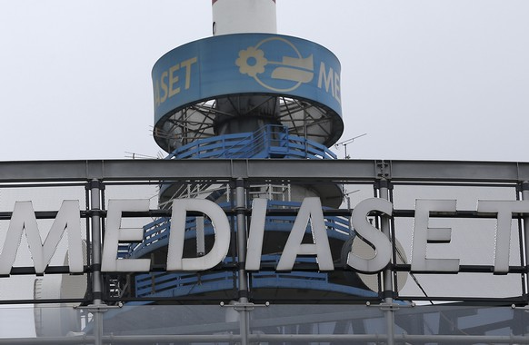 In this photo taken on Monday, Sept. 30, 2013, a view of the Mediaset TV headquarters in Cologno Monzese, near Milan, Italy. French media company Vivendi says Wednesday, Dec. 14, 2016 it has acquired a 20 percent stake in Italy's Mediaset in what the media company of former Premier Silvio Berlusconi says is a hostile takeover bid.  (AP Photo/Antonio Calanni)