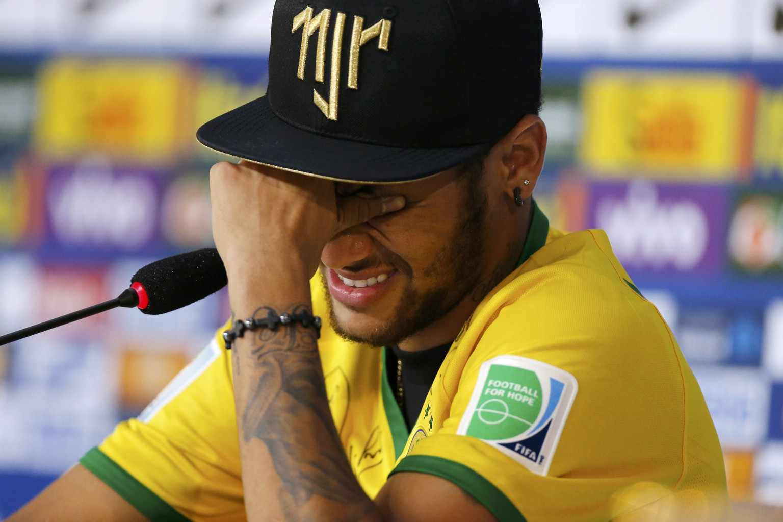 Injured Brazilian national soccer team player Neymar cries during a news conference in Teresopolis, near Rio de Janeiro, July 10, 2014.  REUTERS/Marcelo Regua   (BRAZIL  - Tags: SOCCER SPORT WORLD CUP)