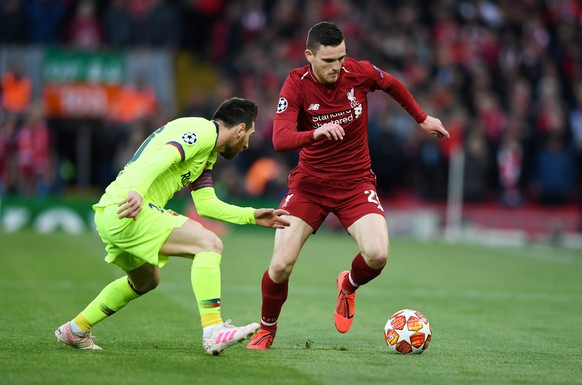 epa07554485 Andy Robertson (R) of Liverpool and Lionel Messi of Barcelona in action during the UEFA Champions League semi final second leg soccer match between Liverpool FC and FC Barcelona at Anfield, Liverpool, Britain, 07 May 2019.  EPA/NEIL HALL