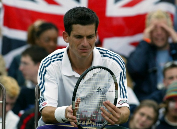 WIM41 - 20020701 - WIMBLEDON, UNITED KINGDOM : Britain's Tim Henman during a break in the fourth round match against Swiss Michel Kratochvil at the Wimbledon Tennis Championships, 01 July 2002.   EPA PHOTO  EPA / GERRY PENNY /gh