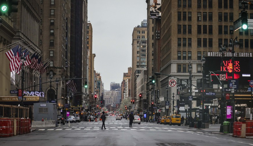 A usually busy 7th Avenue is mostly empty of vehicles, the result of citywide restrictions calling for people to stay indoors and maintain social distancing in an effort to curb the spread of COVID-19, Saturday March 28, 2020, in New York. President Donald Trump says he is considering a quarantine affecting residents of the state and neighboring New Jersey and Connecticut amid the coronavirus outbreak, but New York Gov. Andrew Cuomo said that roping off states would amount to