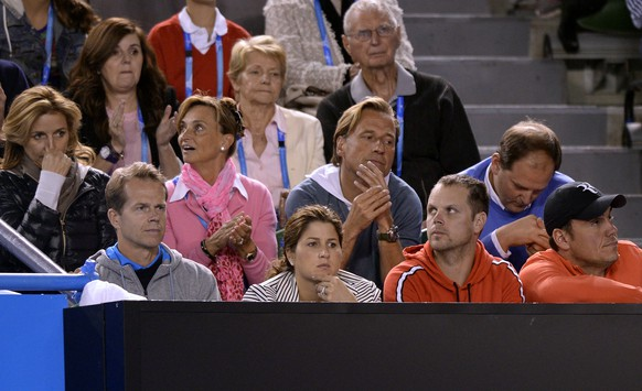 Stefan Edberg,  front left, former Grand Slam champion and coach of Switzerland's Roger Federer, and Federer's wife Mirka, front second left, watches his semifinal against Rafael Nadal of Spain at the Australian Open tennis championship in Melbourne, Australia, Friday, Jan. 24, 2014.(AP Photo/Andrew Brownbill)
