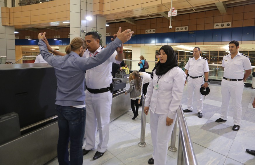 epa05013255 Egyptian scurity check Russian tourists, as they depart from the Sham el-Sheikh airport in Sharm el- Sheikh, Egypt, 05  November 2015. Britain suspended flights from Egypt's Sharm el-Sheikh airport late 04 November 2015 after concerns that an 'explosive device' may have caused the weekend crash that killed 224 people on board a Russian plane flying from Sharm el-Sheikh to St. Petersburg in Russia. The British move followed reports by Russia's Interfax news agency on 03 November 2015 that unusual sounds were recorded in the cockpit as the Russian jet crashed in Egypt's Sinai Peninsula, and US media reports that satellite images had detected a heat flash at the time of the crash.  EPA/KHALED ELFIQI
