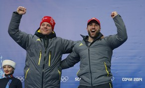 Switzerland's pilot Beat Hefti (L) and Alex Baumann celebrate a second place in the two-man bobsleigh event at the 2014 Sochi Winter Olympics, at the Sanki Sliding Center in Rosa Khutor February 17, 2014.                      REUTERS/Fabrizio Bensch (RUSSIA  - Tags: SPORT BOBSLEIGH OLYMPICS)