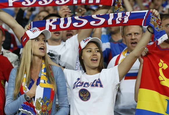 epa05366659 Russia supporters sing their national anthem before the UEFA EURO 2016 group B preliminary round match between Russia and Slovakia at Stade Pierre Mauroy in Lille, France, 15 June 2016.  (RESTRICTIONS APPLY: For editorial news reporting purposes only. Not used for commercial or marketing purposes without prior written approval of UEFA. Images must appear as still images and must not emulate match action video footage. Photographs published in online publications (whether via the Internet or otherwise) shall have an interval of at least 20 seconds between the posting.)  EPA/LAURENT DUBRULE   EDITORIAL USE ONLY