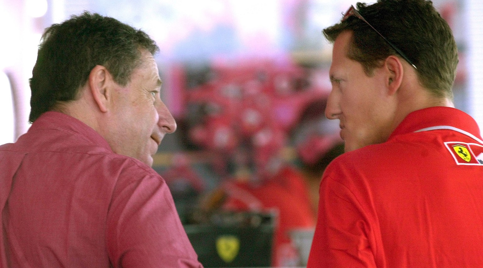 Germany's Michael Schumacher, right, talks to Ferrari team manager Jean Todt in Budapest, Thursday Aug. 16, 2001, prior to Sunday's Hungarian Grand Prix. Schumacher needs to take three points in the race to clinch his fourth World championship. (KEYSTONE/AP Photo/Darko Vojinovic)