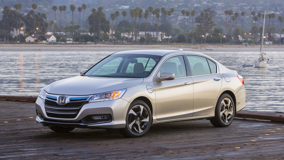 This undated product image provided by Honda shows the 2014 Honda Accord Plug-in Hybrid vehicle. The fuel-thrifty Accord four door, the first with an electric plug, is propelled by stored electric power on most short trips of up to 13 miles. (AP Photo/Honda)