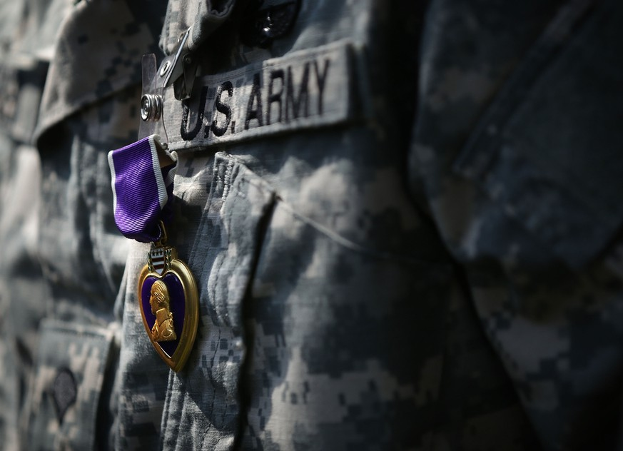 MOUNT VERNON, VA - JUNE 09:  A Purple Heart medal is seen pinned on a recipient's uniform during a Purple Heart ceremony June 9, 2015 at George Washington's Mount Vernon in Mount Vernon, Virginia. The U.S. Army held celebration for its 240th birthday.  (Photo by Alex Wong/Getty Images)