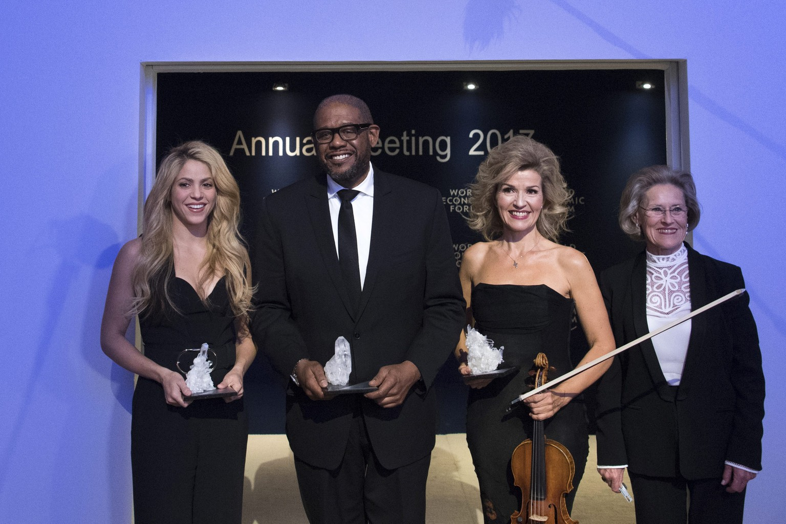 epa05722279 (L-R) Colombian singer and UNICEF Global Ambassador Shakira, US actor and social activist Forest Whitaker, German violinist Anne-Sophie Mutter and Hilde Schwab, Chairperson and Co-Founder of Schwab Foundation for Social Entrepreneurship, pose after the Crystal Award Ceremony on the eve of the 47th annual meeting of the World Economic Forum (WEF) in Davos, Switzerland, 16 January 2017. The annual meeting brings together business leaders, international political leaders and select intellectuals, to discuss the pressing issues facing the world. The overarching theme of the 2017 meeting, which takes place from 17 to 20 January, is 'Responsive and Responsible Leadership'.  EPA/GIAN EHRENZELLER