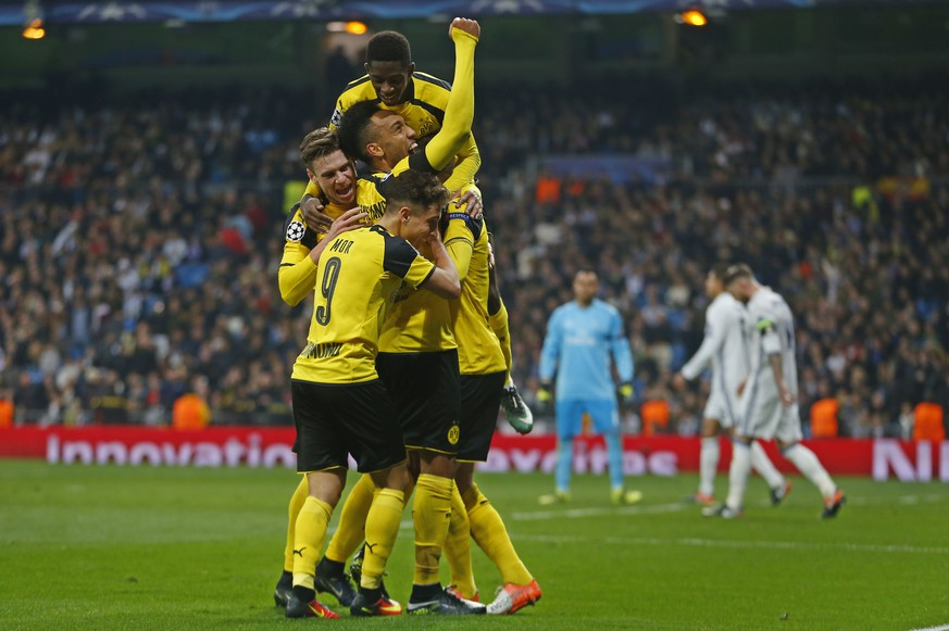 Dortmund players celebrate after Marco Reus scored his side's 2nd goal during the Champions League, Group F, soccer match between Real Madrid and Borrusia Dortmund at the Santiago Bernabeu stadium in Madrid, Spain, Wednesday, Dec. 7, 2016. (AP Photo/Francisco Seco)