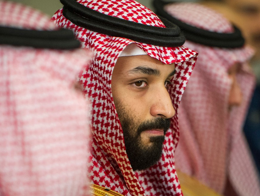FILE - In this March 22, 2018, file photo, Saudi Crown Prince Mohammed bin Salman meets with U.S. Defense Secretary Jim Mattis at the Pentagon in Washington. In a kingdom once ruled by an-ever aging rotation of elderly monarchs, Saudi Crown Prince Mohammed bin Salman stands out as a youthful face of a youthful nation. But behind a carefully coiffed public-relations operation highlighting images of him smiling in meetings with the world's top business executives and leaders like President Donald Trump, a darker side lurks as well.(AP Photo/Cliff Owen, File)