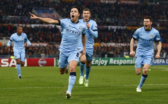 ROME, ITALY - DECEMBER 10:  Samir Nasri of Manchester City celebrates scoring the first goal during the UEFA Champions League Group E match between AS Roma and Manchester City FC on December 10, 2014 in Rome, Italy.  (Photo by Julain Finney/Getty Images)