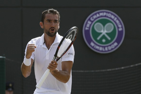 Croatia's Marin Cilic celebrates winning a second set against Steve Johnson of the United States during their Men's Singles Match on day five at the Wimbledon Tennis Championships in London Friday, July 7, 2017. (AP Photo/Kirsty Wigglesworth)