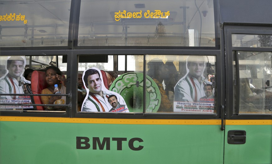 Supporters of India's Congress party President Rahul Gandhi travel in bus with his cutouts to attend an election campaign rally in Bangalore, India, Sunday, March 31, 2019. India's general elections will be held in seven phases starting April 11. (AP Photo/Aijaz Rahi)
