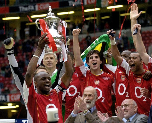 ** CORRECTS TO POOL PHOTO ** Arsenal captain Patrick Vieira lifts the FA Cup after defeating Manchester United in the FA Cup Final at the Millennium Stadium, Cardiff, Wales, Saturday May 21, 2005. Arsenal won the match 5-4 on penalties after the match ended 0-0 after extra-time. (AP Photo/ Rebecca Naden, Pool)