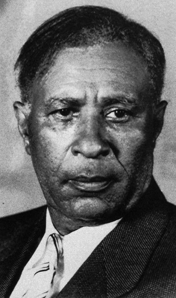 FILE – This 1945 file photo shows inventor Garrett A. Morgan. Living in Cleveland as an adult, Morgan received a patent in 1914 for a gas mask he developed, and helped found the Cleveland Association of Colored Men in 1908. Morgan is buried at Lake View Cemetery in Cleveland. Cleveland is hosting the Republican National Convention from Monday through Thursday, July 18 to 21, 2016. (AP Photo, File)