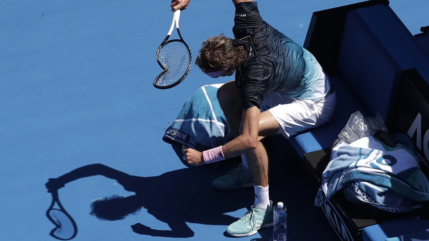 Germany's Alexander Zverev smashes his racket in frustration during his fourth round match against Canada's Milos Raonic at the Australian Open tennis championships in Melbourne, Australia, Monday, Jan. 21, 2019. (AP Photo/Kin Cheung)
