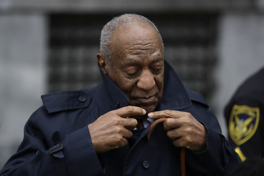 Bill Cosby adjusts his coat after his sexual assault trial, Thursday, April 19, 2018, at the Montgomery County Courthouse in Norristown,Pa. (AP Photo/Matt Slocum)
