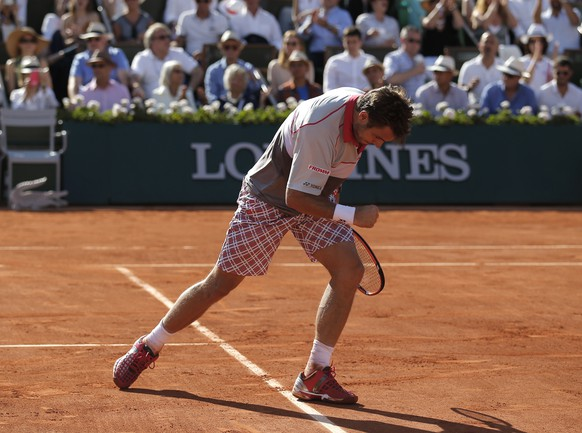 Switzerland's Stan Wawrinka reacts shortly before defeating Serbia's Novak Djokovic in their final match of the French Open tennis tournament at the Roland Garros stadium, Sunday, June 7, 2015 in Paris.  (AP Photo/Francois Mori)