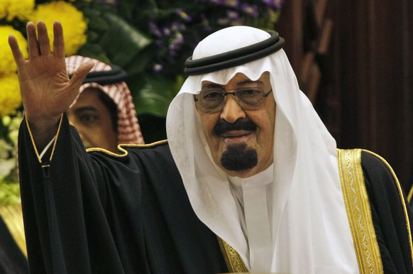 FILE - In this Tuesday, March 24, 2009 file photo, King Abdullah bin Abdul Aziz al-Saud of Saudi Arabia, waves to members of the Saudi Shura