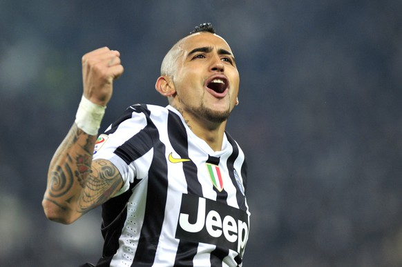 FILE - In this Feb. 2, 2014 file photo Juventus' midfielder Arturo Vidal of Chile celebrates after scoring during a Serie A soccer match between Juventus and Inter Milan at the Juventus stadium, in Turin, Italy. Bayern Munich says Thursday, July 23, 2015 it's close to signing Chile midfielder Vidal from Italian champion Juventus. (AP Photo/Massimo Pinca, File)