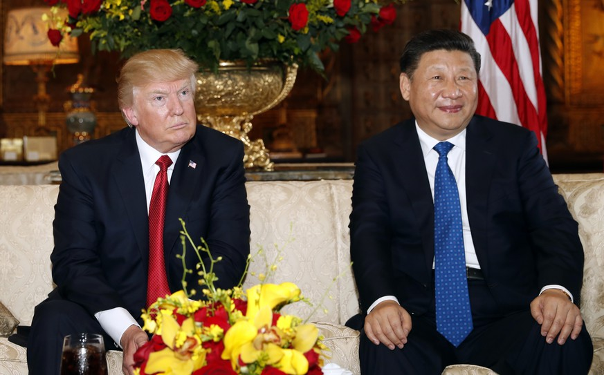 President Donald Trump and Chinese President Xi Jinping, sit as they pose for photographers before a meeting at Mar-a-Lago, Thursday, April 6, 2017, in Palm Beach, Fla. (AP Photo/Alex Brandon)