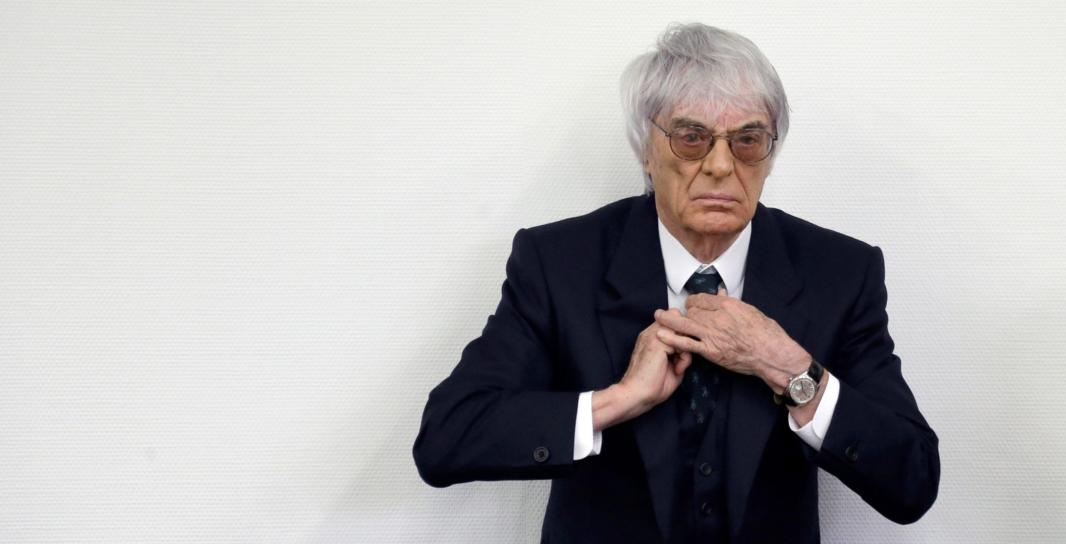 epa04215088 Formula One boss Bernie Ecclestone adjusts his tie as he arrives for the sixth day of his trial at the regional court in Munich, Germany, 20 May 2014. Ecclestone is charged with bribery and incitement to breach of trust 'in an especially grave case' over a 44 million US dollar payment to a German banker, that prosecutors allege was meant to facilitate the sale of the Formula One Group to a buyer of Ecclestone's liking.  EPA/MATTHIAS SCHRADER / POOL POOL PHOTO