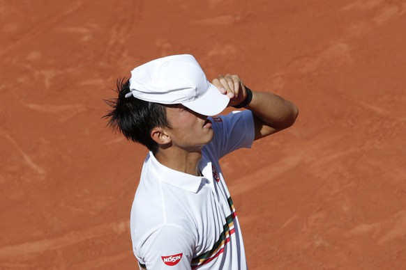 Japan's Kei Nishikori adjusts his cap as he plays Spain's Fernando Verdasco during their fourth round match of the French Open tennis tournament at the Roland Garros stadium, Monday, June 5, 2017 in Paris. (AP Photo/Christophe Ena)
