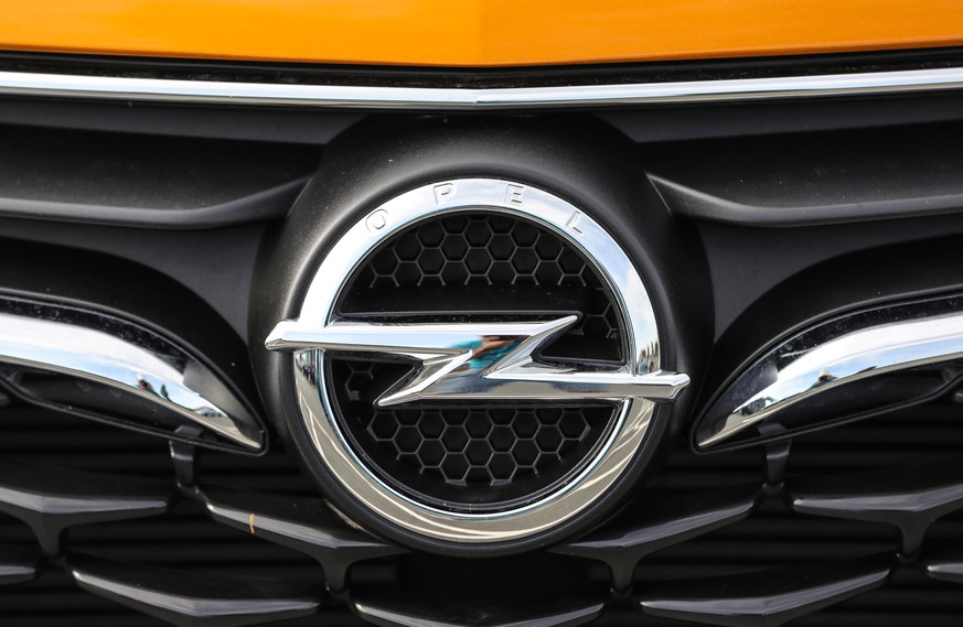epa08127167 (FILE) - A Opel logo is seen at a car for sale at a dealer shop in Ruesselsheim, Germany, 05 July 2018 (reissued 14 January 2020). German media reports on 14 January 2020 state Opel is to inform its staff of plans to cut up to additional 4100 jobs in Germany in coming years. Some 6,800 Opel employees in Opel's German factories have already signed agreed to various forms of leaving the company.  EPA/ARMANDO BABANI *** Local Caption *** 54701862