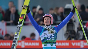 Germany's winner Severin Freund celebrates after the final jump of  the Ski Jumping World Cup in Bad Mitterndorf, Austria, on Saturday, Jan. 10, 2015. (AP Photo/Kerstin Joensson)