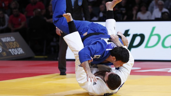 epa07359931 Varlam Liparteliani of Georgia (white) in action with Aaron Wolf of Japan (blue) during the men's -100kg judo final, during the Paris Grand Slam judo tournament, in Paris, France, 10 February 2019.  EPA/IAN LANGSDON