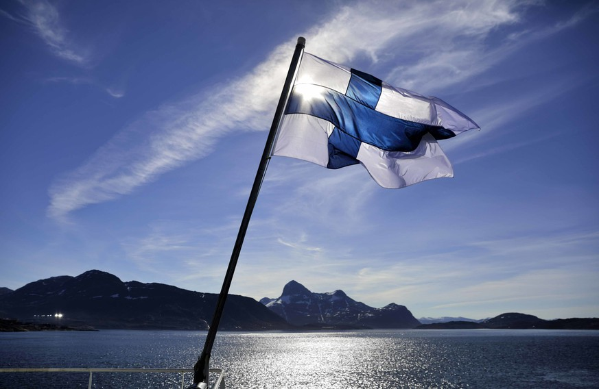 FILE - In this Saturday, July 29, 2017 file photo, Finland's flag flies aboard the Finnish icebreaker MSV Nordica as it arrives into Nuuk, Greenland. A nationwide experiment with basic income in Finland has not increased employment among those participating during the first half of the two-year trial, but their general well-being seems to have increased, a report said Friday Feb. 8, 2019. (AP Photo/David Goldman, file)