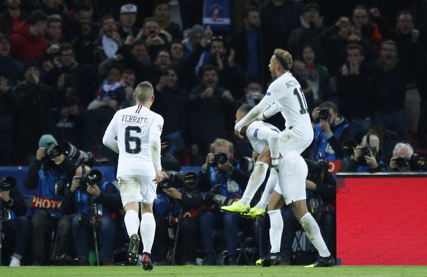 PSG forward Neymar, right, is carried by PSG forward Kylian Mbappe after scoring his side's second goal during a Champions League Group C soccer match between Paris Saint Germain and Liverpool at the Parc des Princes stadium in Paris, Wednesday, Nov. 28, 2018. (AP Photo/Francois Mori)
